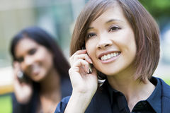 Beautiful Chinese Woman On Her Cell Phone Royalty Free Stock Images