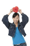 Beautiful Chinese woman holding a red heart Royalty Free Stock Image