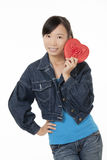 Beautiful Asian woman holding a red heart flirting isolated on a white background Royalty Free Stock Image