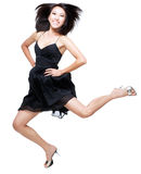 Beautiful Chinese woman jumping up in excitement. Studio portrait of young, beautiful chinese girl jumping up in joy and excitement Stock Image