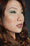 Beautiful Chinese woman with makeup looking away Royalty Free Stock Photography