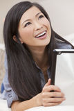 Beautiful Chinese Woman Using Tablet Computer Stock Images