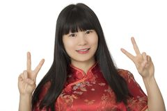 Beautiful Chinese woman wearing a Chipao isolated on white backg Stock Image