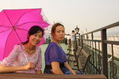 Beautiful chinese women on the boat royalty free stock photography
