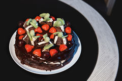 Beautiful chocolate cake with fresh berry Stock Photos