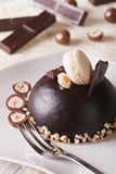Beautiful chocolate cake with nuts and macaroon, vertical Royalty Free Stock Images