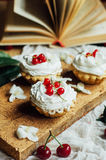 Beautiful chocolate cupcakes with white protein cream and cherry Stock Image