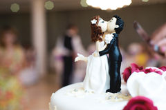 Beautiful chocolate figurines on top of wedding. Cake Stock Photo