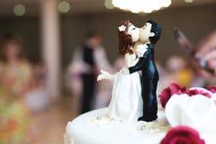 Beautiful chocolate figurines on top of wedding Stock Photo