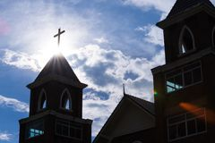 Christian church silhouetted flare sunlight background Stock Images