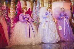 Beautiful Christmas Angels on display for the Holidays. Three porcelain christmas angels on display wearing vintage dresses during the holidays royalty free stock images