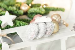 Beautiful Christmas background with cookies Snowball on wooden. Sledge and fir tree Stock Photography