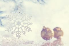 Beautiful christmas background, snowflake and christmas balls. Toned photo. Selective focus. royalty free stock images