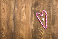 Beautiful Christmas background Wooden Copy space Candy cane Top view. Beautiful Christmas background Wooden Copy space Candy cane royalty free stock images