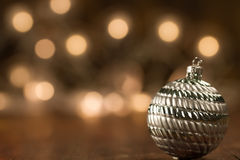 Beautiful Christmas ball on the defocused background of lights. Stock Photos