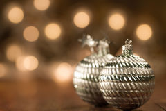 Beautiful Christmas ball on the defocused background of yellow lights. Royalty Free Stock Image