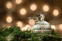 Beautiful Christmas ball defocused background of yellow lights. Festive decoration. Royalty Free Stock Images