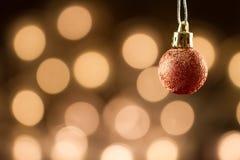 Beautiful Christmas ball defocused background of yellow lights. Festive decoration. Royalty Free Stock Photos