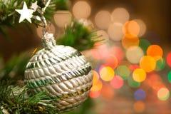 Beautiful Christmas ball defocused background of yellow lights. Festive decoration. Royalty Free Stock Image