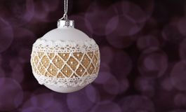 Beautiful christmas ball white toy with pattern. Beautiful festive white toy ball with a pattern in winter time for the new year Stock Photo