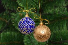 Beautiful Christmas balls on  background of green fir-tree Royalty Free Stock Photos