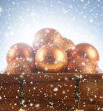 Beautiful Christmas balls in a brown chest royalty free stock photo