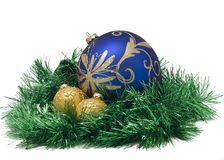 Beautiful Christmas balls in green tinsel Stock Photos