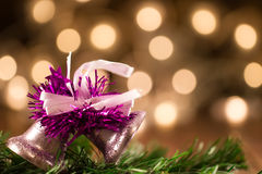 Beautiful Christmas bell in the background defocused yellow lights. Royalty Free Stock Photos