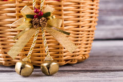 Beautiful christmas bell with cones on a wooden basket. stock photos
