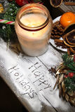 Beautiful Christmas candle and decorations Stock Photos