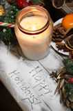 Beautiful Christmas candle and decorations Stock Photo