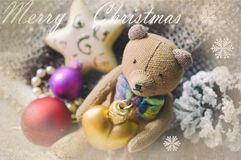 Beautiful Christmas card with Teddy bear, necklace, pine cone and Christmas tree toys. Holiday greeting card. Cover, wrapper Royalty Free Stock Photography