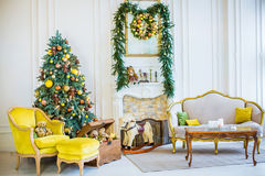 Beautiful Christmas children`s room,. Christmas tree and gifts. studio stock photos