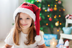 Beautiful Christmas close portrait of little preschool girl at h royalty free stock photography