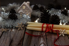 Beautiful christmas composition on wooden background. Rustic background with candles for christmas Stock Images