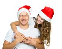 Beautiful Christmas couple in Santa hats Royalty Free Stock Photos