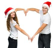 Beautiful Christmas couple in Santa hats Stock Photo