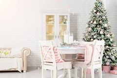 Beautiful Christmas decorated light living room with a Christmas royalty free stock image