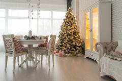 Beautiful Christmas decorated light living room with a Christmas stock photo
