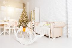 Beautiful Christmas decorated light living room with a Christmas stock images