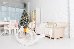 Beautiful Christmas decorated light living room with a Christmas stock photography