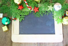 Beautiful Christmas decoration and chalkboard on wooden background Royalty Free Stock Photo