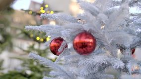 Beautiful Christmas Decoration. Christmas tree decoration on the street of the city on a day time, frozen fir or spruce branches stock video