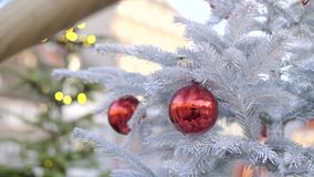 Beautiful Christmas Decoration. Christmas tree decoration on the street of the city on a day time, frozen fir or spruce branches stock video footage