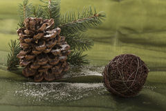 Beautiful christmas decoration, with cone, pine branch. Beautiful christmas decoration, on the green background Stock Photos