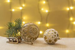 Beautiful christmas decoration, with sledge, pine branch, and knitten xmas balls Stock Image