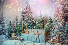 Beautiful Christmas decoration. Swing, on the background of the Christmas tree stock photography