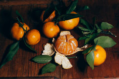 Beautiful Christmas decoration with tangerines in the night light garlands. Citrus still life. The symbol of the new year Royalty Free Stock Image