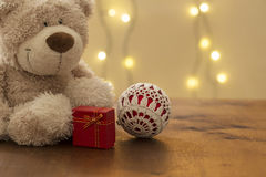Beautiful christmas decoration, with teddy bear gift package and knitten xmas ball Stock Photos