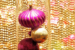 Beautiful Christmas decorations against a  golden beaded curtain Stock Photos